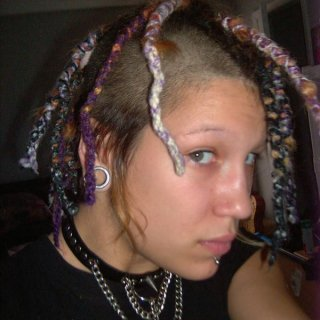 this was in 2008 i want to say i had wraped all my dreads in yarn it lead to alot of static shock lol