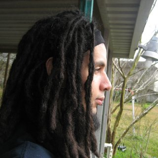 "I loved the way my locks gave me this look. Photo taken in 2006. Since my hair is much longer I don't think it gives me this ""Lion's mane"" look as easy as it did before."