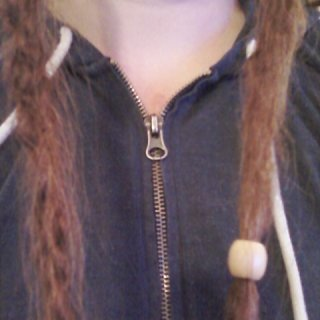a one month old twist n rip dread on the left, a three month old tnr dread on the right!