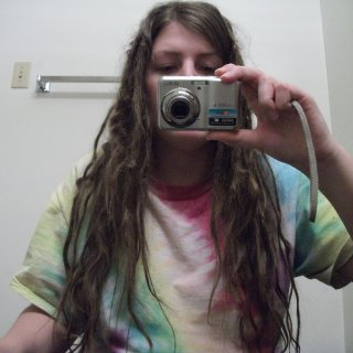This is the front view of my 11 week old dreads.