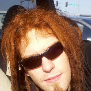 less than a day after putting in the henna, im a total carrot top :D cant wait to see what the color will look like oxidized. i hope it gets more red than orange. anyway, weird pose, i was in the car waiting on my passenger to get out of the bank, leaned over in the sun to take the photo. just realized, 10 month anniversary. yay!