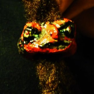 Here is another dread bead I created using polymer clay and acrylic paints