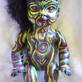 I created this piece using an old baby doll,turkey feathers,and lots of acrylic paint