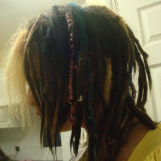 I do not tidy my dreads I just leave them to do there thing