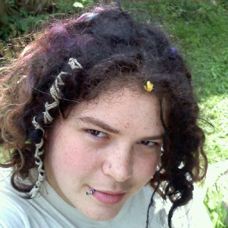 Me hanging outside about 8 month dreads, they feel a lot more mature than they look I think :P
