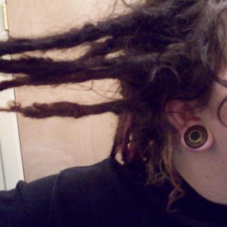 """5 months old T&R dreadlocks and 1"""" stretched lobes."""