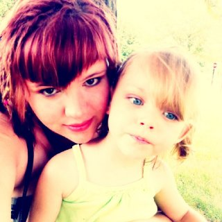 Me and my daughter hangin' out in the sun