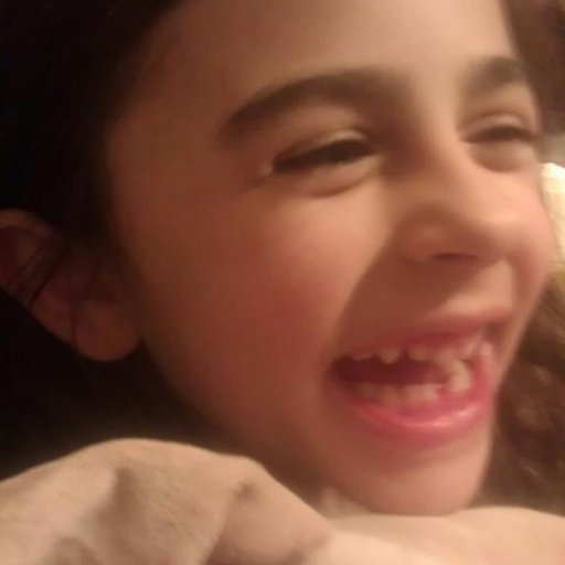 Lost her first tooth!