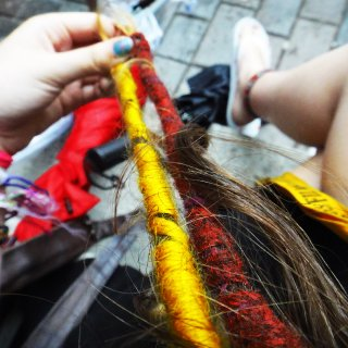 yellow and red dread decorations with wool