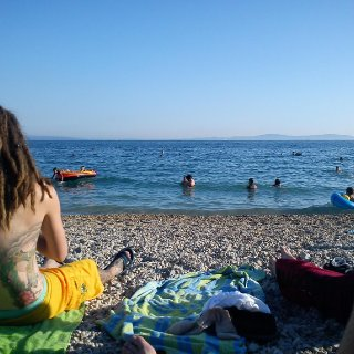 backpacking across europe, sitting on the beach in Croatia