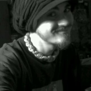my black rasta tam. the little strips have the rasta colors. its a black n white pic so you cant see them. love this tam. people call it my funny hat