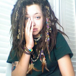 i had something in my eye wasnt ready for the picture but my dreads look awesomee