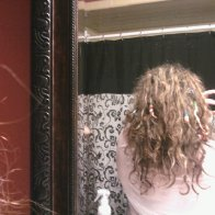 ive lost LOTS of length! especially lately. every time i wash it shrinks and curls up more.