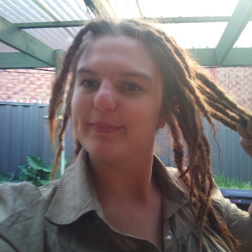 showing off my nice dreads at about 4 days