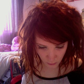growing slowly but surely :)  i just re-hennaed my hair last night so they are all reddy orange again :)