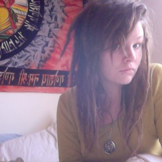 my bed head + half dreads half regular hair. i can dig it:)