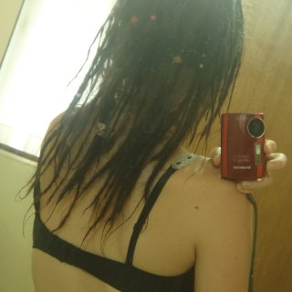 dunno in inches how long that is buut its down to my bra strap! lol