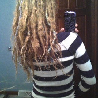 my hair is shrinking alot, there are only some thin wispy strands of hair that havnt gotten sucked into the dreads yet