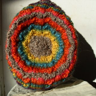 A bright warm tam displaying the colors of a free spirit, this wool hat would be perfect for small or medium dreads!  http://www.etsy.com/listing/85572255/winter-wear-warm-beanie-slouch-hat