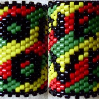 "One of my favs! This is a dread bead sleeve with wrap around lettering that says ""One Love"".  http://www.etsy.com/listing/86385455/one-love-rasta-dread-bead-hair-accessory"