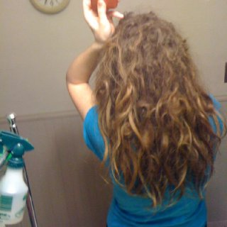 22-23 weeks - The bulk of my hair is now by my shoulders. The rest hanging down are the remaining ends of loops