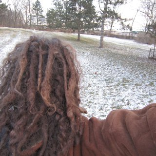 I like the way they look outside haha. that swirl on the end of that one dread is cool to.