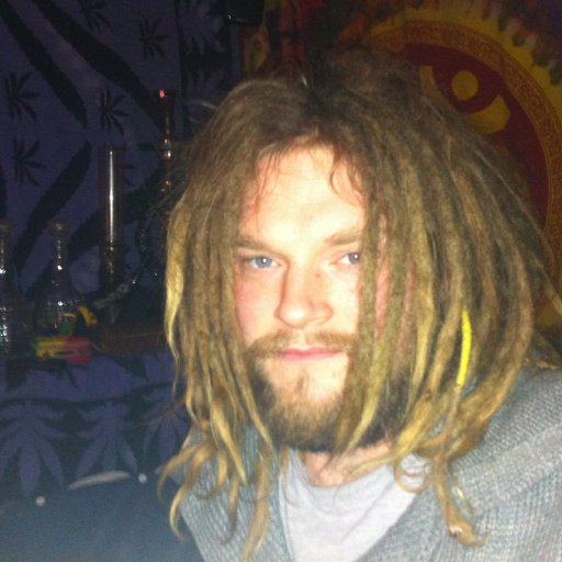 dreads clean and beard growing like a mental