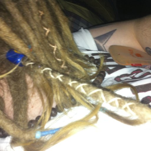 That will do sam that will do! One wrap in the back of my dreads not bad as I couldn't see.