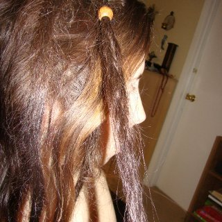 This is my one twist and rip dread. You can kinda see the backcombed one near it. Only top ones I have done. The t&r dready's birthday is 1/16/12