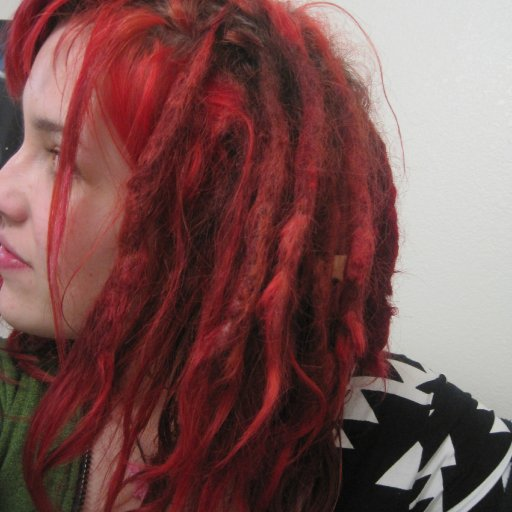 formerly shaved side, young dreads