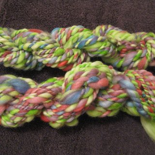 my second spin from my first hand dyed roving, not what i expected but i love it anyways. i'm having fun with spin