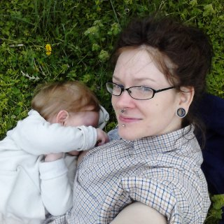 Nursing my 2 yr old. Because that IS normal and all toddlers should still be breastfeeding if you can. <3  And I can't believe how much of a red tint my hair still has! I have been dying it for 15 years but the top part of my head is my real color. I was born with bright red hair but the color changed alot during my childhood. So cool to see my real color again!