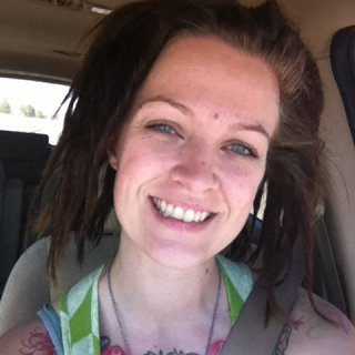 This is the first day of my dreads. I had them backcombed and twisted then waxed. I have since removed the wax.
