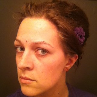 I am trying to find a way to wear my hair and have it work...this is what I have come up with so far. :)