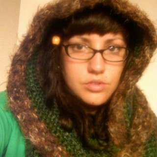 This is a hooded scarf I made. 5 different skeins of thick (5/6 ply) yarn in green/brown color scheme.