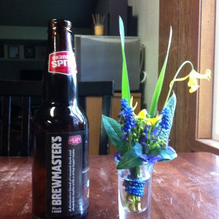 gotta love spring. the kids n i just made a shotglass boquette. i put it beside a bottle just so you could see the size