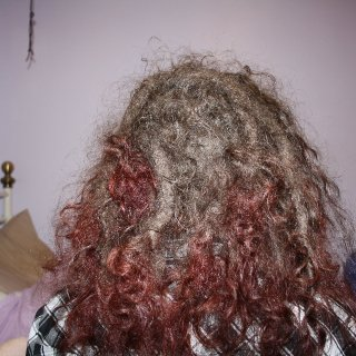 Flash makes my dreads look weird, but can't really see the colour without it.