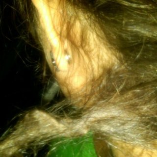 My favorite dread, pulled straight. Hehe, it just kinda zig-zags up really fast when I let it go.