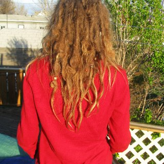 My natural tree roots turned 1 on May 7th, 2012!I've done nothing but wash my hair once a week with Baking soda and give them all the love in the Universe.