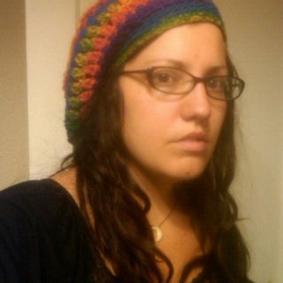 Dreads down. Calypso is the yarn I used... Synthetic bobble stitched tam I made today. I think this particular yarn is nice but I need to rework the brim (I don't personally like it.)