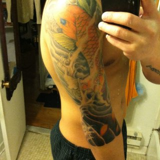 koi fish showin off my asian side.  Im half filipino/hawaiian  soon to get my right with my hometown tribal signs