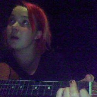 Ukulele video snapshots and shtuff. My hot red, and purple hair is not dreaded, the light in the back is my dreads.