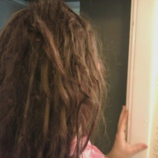It has been a whole year now since I stopped brushing my hair. (: