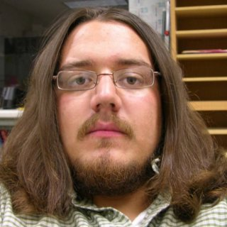 This is a bit older. I've shaved my head and grown it back out since this. But it's the best one to show how my hair is normally