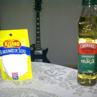baking soda and aplesseed vinegar and my guitar on the background