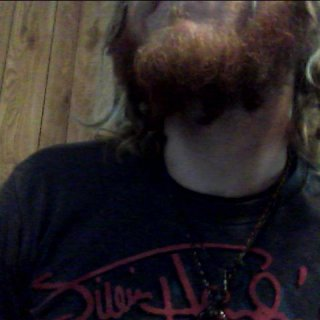 the beginning of beard dreads