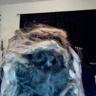 finally seeing roots real color and healthy. everyone should go natural. dont get your hair interlocked:) haha like i did.