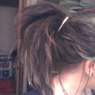 I swear I am not tying my hair up all the time and that isn't very tight. I got some cute scarves to wrap my hair in. :) I am so in love with my hair. Though I admit the newly born dread frizziness is driving me a bit nuts. But I know it is all apart of the journey. :)