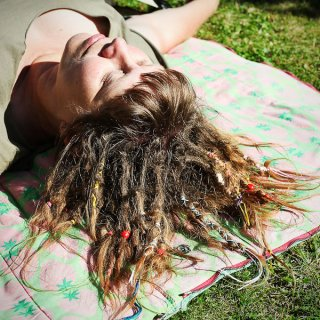 My husband took this picture when I was out in the sun trying to become more blond. Whenever I'm in the sun I try to expose my dreads as much as I can. Unfortunately the sun has been scarce this summer.