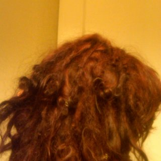 Here is my hair at 4 and a half months old. :)  Right side view... My red looks kinda brown in the dim lighting...